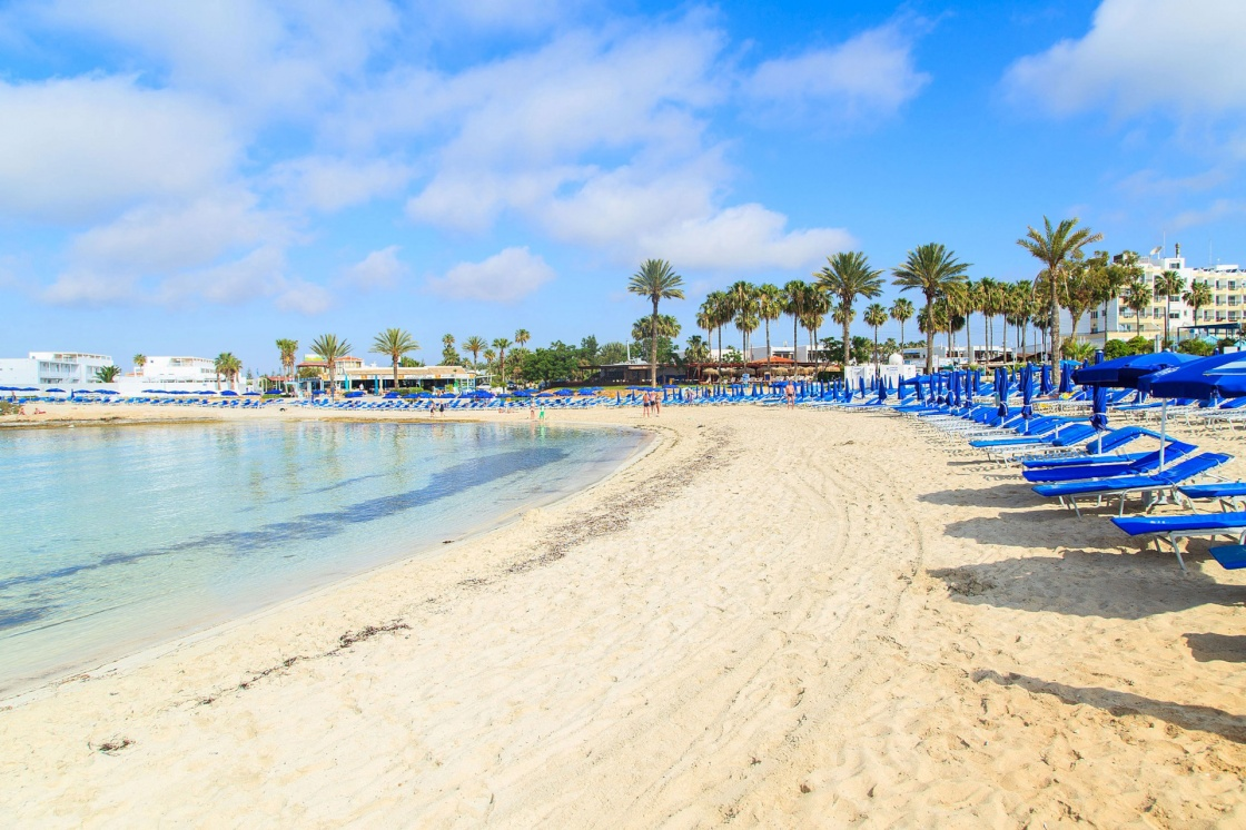 'Blue beach umbrellas and sunbeds on Sandy Beach in Ayia Napa, Cyprus' - Cyprus
