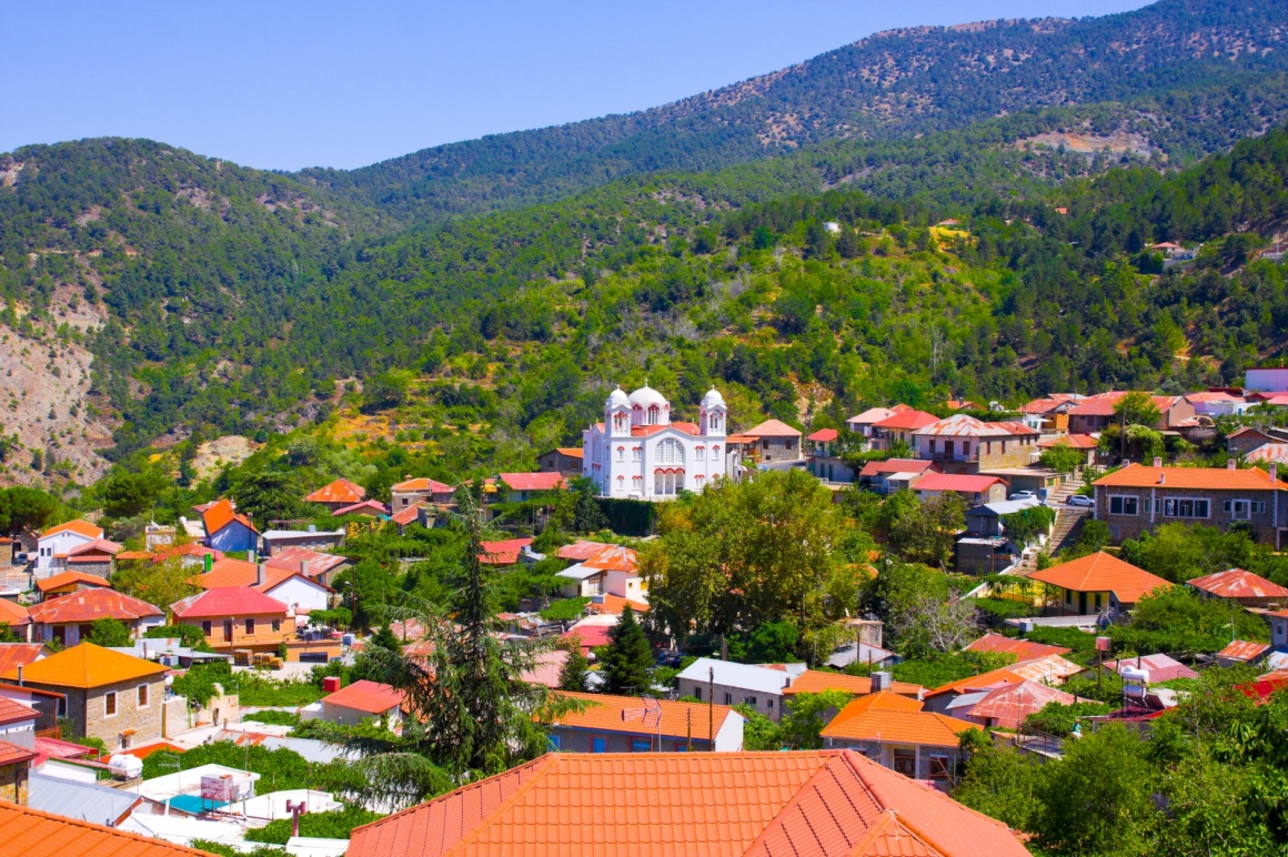 'Mountain Village Pedoulas, Cyprus. View over roofs of houses, mountains and Big church of Holy Cross. Village is one of most picturesque villages of Troodos mountain range ' - Cyprus